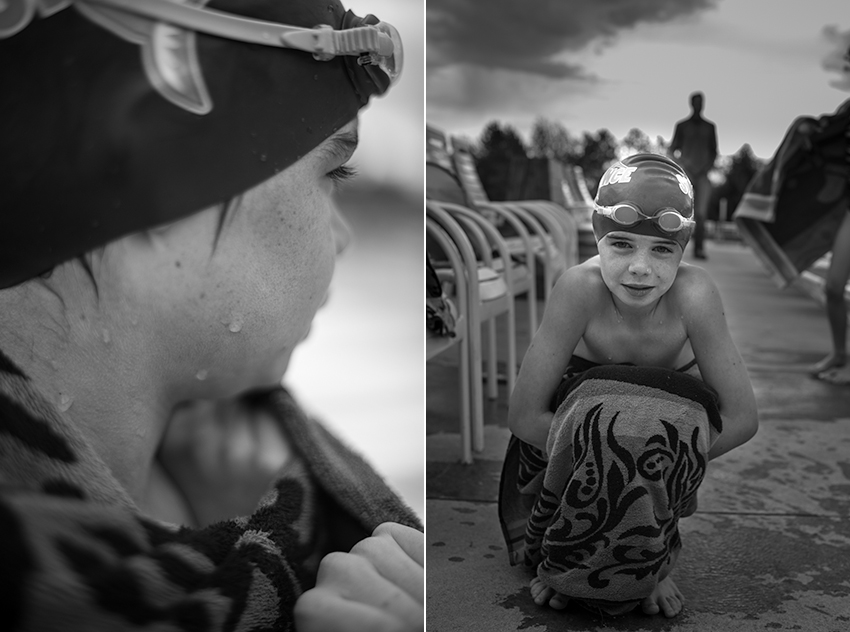 Photograph of a boy drying off at the side of a Denver area pool on a cold summer morning after swim team.