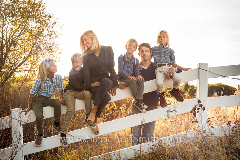 Fall family portrait on a fence with quadruplets
