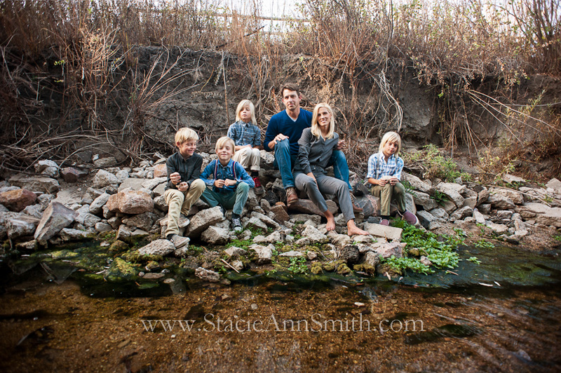 fall family portrait at a creek with quadruplet boys near Denver