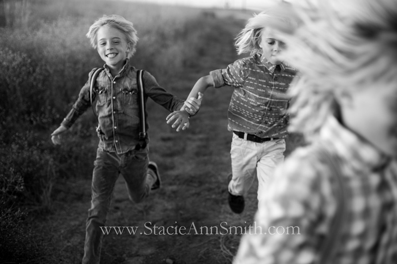 b&w photograph of boys running